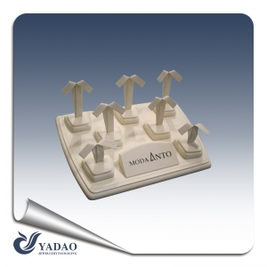 A customized small exquisite earring display set covered with high quality microfiber.