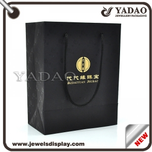 Black good quality god logo pattern around shopping bag hard paper