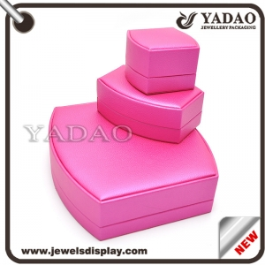 China Newest shape plastic mold wrapped with pink PU leather jewelry packing boxes for shop counter and kiosk party favors jewelry display box