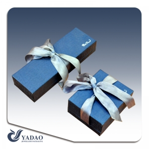 China jewelry packaging manufacturer of Luxury blue hard paper boxes and chests  for jewelry and gift showcase and display used in shop counter and window with ribbon