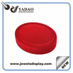 Classic velvet red oval ring box with a hinge made of quite downy and smooth velvet material with good quality
