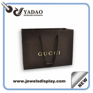 Custom size and color line paper packaging bag with handles and logo printed