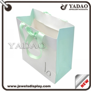 Customed logo printing fashion shopping bags for jewelry display and gift packing strong paper handbag