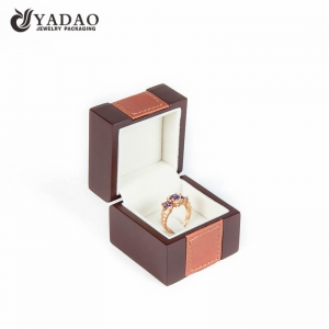 High end handmade wooden brown ring box covered with leatherette suitable for packing and displaying fine jewelry.