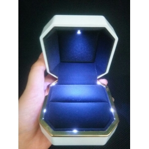 High end octagon ring box with shiny LED light covered with shiny lacquer in stock.