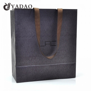 Top quality 210g 230g 250g fancy paper material with texture ribbon handle paper shopping gift bags