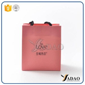 Wholesale new design pink paper gift bag shopping craft handbag with free logo customize