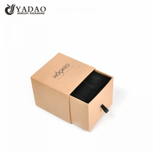 Yellowish cardboard jewellery box drawer style with black pillow insert