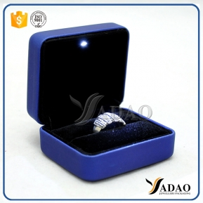 China Chinese handmade pu leather cover LED light jewelry box metal ring box with LED in factory