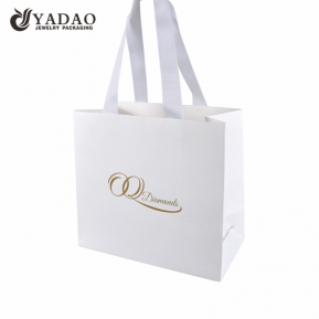 Čína Christmas gift packaging bag fancy paper bag jewelry packing paper bag gift shopping bag with ribbon handle  továrna