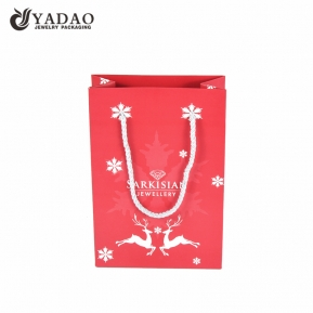 China Christmas theme gift paper bag paper shopping bag handle rope for gift packing  factory