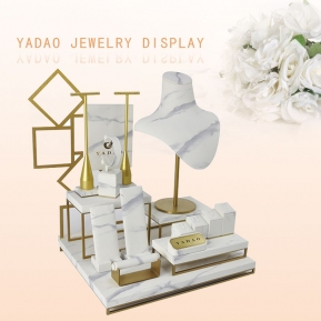 China Custom White High-Gross Gold Brushed Metal with Marbled PU Leather Jewelry Display Stand factory