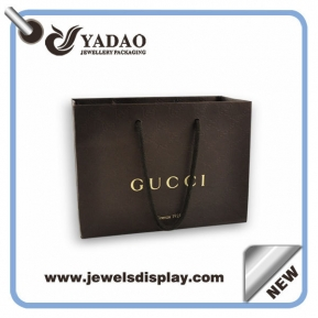 China Custom size and color line paper packaging bag with handles and logo printed factory