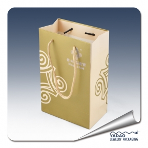 China Gold color paper jewelry gift bags with handle and gold color logo Chian supplier factory