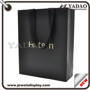 China Luxury classic black paper shopping bags with gold hot stamping logo for shop and shopping mall party favors paper packing bags factory