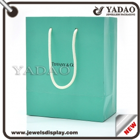 China Most popular blue paper jewelry bag with handstring and your logo factory