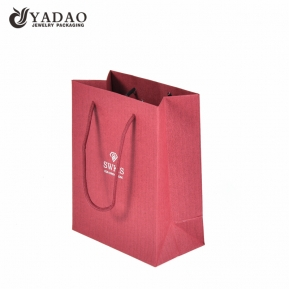 China Yadao High Quality Fancy Paper Bag Christmas Gift Bag Red bag for Shopping with Twisted Rope and Hot Stamping factory