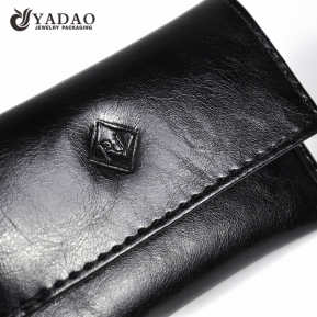 China genuine leather jewelry pouch bag gift packaging bag snap design gift bag embossed logo finish factory